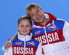 Yulia Lipnitskaya (L) and Evgeny Plyushchenko of the gold medal-winning Russian figure skating team pose for a photo during the medal ceremony for the figure skating team ice dance free dance at the Sochi 2014 Winter Olympics February 10, 2014. REUTERS/David Gray (RUSSIA - Tags: OLYMPICS SPORT FIGURE SKATING)