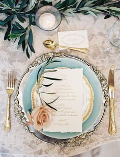 Elegant place setting with a garland table runner and touch of light blue