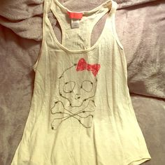 Cute Punk Princess Tank Top This tank top is really cute, with an adorable Skull with a bow on it. I bought it years ago at JCPenny and haven't worn it since the day I tried it on. Super soft cotton.  Offer me anything!!  Soul Cake Tops Tank Tops