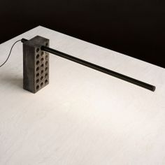 Composed of two simple components, the Brick Lamp has an industrial look that will complement a rustic interior or provide a distinctive contrast to a sleek, modern room. In two different shades of black, the Brick Lamp is a neutral light with a sculptural slant. Designed by Philippe Malouin, the lamp is comprised of a perforated concrete brick and an aluminum cylinder outfitted with an LED array. The LED can be moved in a variety of places, making it an adjustable lamp for a desk…