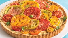 Enjoy this savory tart layered with cheese and tomatoes - dinner made using Bisquick® mix.