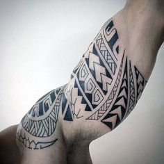 Bicep Mens Maori Tattoo Design In Black Ink