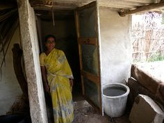 A woman with her new toilet in #India.