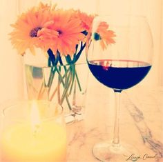 a perfect evening... good wine, a nice candle and pretty flowers #happiness