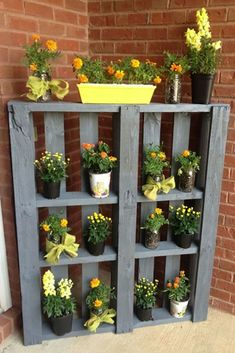 Paint an old pallet and show off your favorite flowers near your front door, in a corner of your garden or even on a balcony. The vertical display takes up very little space, and you can change out the flowers or decor with each season to keep things fresh! Get the tutorial.