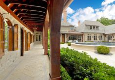 Private Residence - French Casual - traditional - exterior - dallas - Harold Leidner Landscape Architects.  French Country stone, shutters, beautiful arched windows