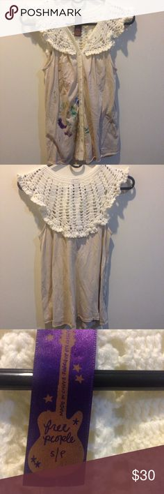 FREE PEOPLE Cream Sweater Knit Top Blouse Free People blouse with a knit neckline and buttons down center. Metallic colors brushed onto the outside front in purple and blue colors. In great condition! Size small Free People Tops Tank Tops