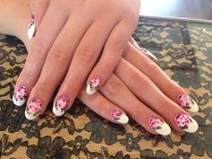 Sculpted acrylic nails using young nails acrylic. Cuccio white gel polish and hand painted floral print. Follow me on Instagram nails_by_darling