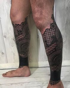 A Blackwork Tattoo is an abstract geometric shape painted in pure black upon the body. Blackwork is pushing dotwork and linework to their extreme, with complex geometrical symmetrical patterns and massive black areas. Calf Sleeve Tattoo, Calve Tattoo, Calf Tattoo Men, Sleeve Tattoos, Full Arm Tattoos, Cover Up Tattoos, Leg Tattoos, Tattoos For Guys, Cool Tattoos