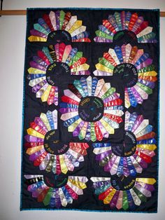A wall hanging I made from my daughter's swimming, track and 4H ribbons.