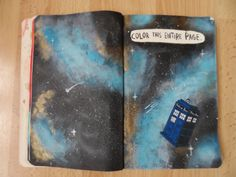 Pages 14 and 15 - Colour this entire page.   I knew I wanted to paint a nebula and then thought a TARDIS would look pretty cool on top.  #WreckThisJournal #wtjsw #DoctorWho #TARDIS #Space #Nebula #Stars