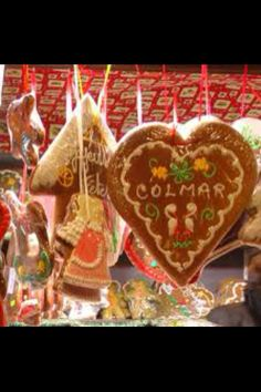 CHRISTMAS IN COLMAR, FRANCE ~ DECORATED GINGERBREAD HEARTS FILL THE STALLS AT THE CHRISTMAS MARKET IN COLMAR. WONDERFUL WITH THE MULLED WINE SOLD NEXT DOOR.