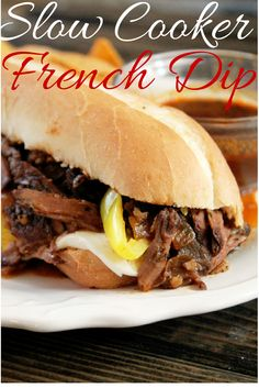 Slow Cooker French Dip Sandwich-You need fresh French hoagie rolls, loads of fresh mozzarella and hot pickled peppers. Place everything on the bun with a little mayo and it's ready to devour!