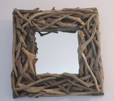 COASTAL: A high quality natural driftwood mirror, the perfect addition to your coastal home. Due to the natural materials used to make the mirror there may be slight variations to the image shown. the Driftwood Mirror is supplied with strong hanging system so it can be safely hung on your wall. Measures approximately 40cm x 40cm - £50. From www.purecoastal.co.uk.