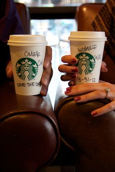 """Save the Dates- couple holding starbucks cups -the cups have their names on them -the groom's cup says """"save the date"""" and the bride's cup has the date on it. Great for the coffee loving couple"""