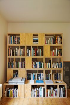 These bookshelves are one element of a minimalist home in England.