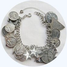 Vintage 1970's charm bracelet loaded with Vita Scientia Amicitia charms