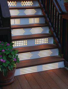 Stairway lighting can be ordinary — or it can be a work of art. Geometric cutouts in each riser allow plenty of light through to illuminate the steps here, but all you really notice are the different patterns. Repeating one pattern on every other riser keeps the design from becoming too busy.