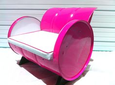 Recycled 55 gallon drum arm chair. Blinding Magenta powder coat with automotive grade white vinyl upholstery.