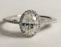 Oval Halo Diamond Engagement Ring. GORGEOUS !