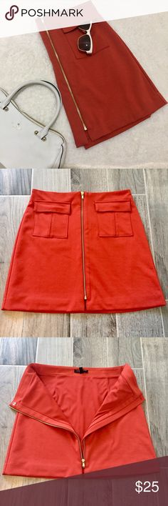 Banana Republic Skirt, Orange, Size 6. Banana Republic, rust orange skirt with functional pockets, and a gold functional zipper. Size 6. NWOT. Would look great with brown boots! Length: 17 inches. Banana Republic Skirts