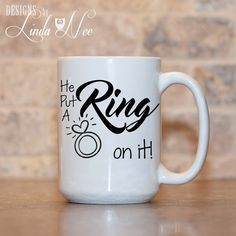 MUG ~ He put a RING on it! ~ Proposal Mug ~ Engaged Cup ~ Engaged Gift ~ Engaged Mug ~ Engagement Mug ~ Bride to Be ~ Coffee Mug ~ Mugs ~ Bridal Shower ~ Bride Please include the exact last name and title abbreviation in the notes to seller box at checkout.  ♥ AVAILABLE SIZES 15 oz 11 oz   AVAILABLE AS A PINBACK BUTTON!!! ♥ ♥ ♥ ♥ ♥ ♥   ♥ ABOUT OUR MUGS ♥ All designs are personally created by me and exclusive to DesignsbyLindaNee ♥♥♥♥♥ http://etsy.me/1O2ftEU ♥♥♥♥♥ and DesignsbyLindaNeeToo ♥…