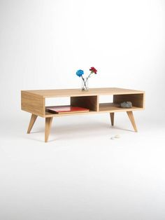 Our coffee table / TV stand is a piece of furniture, which thanks to its gentle form - inspired by the mid-century modern Scandinavian design - offers various applications. Its symmetry opens another, new possibilities - you can place it next to the wall or in the middle of the living room. Our