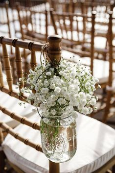 budget rustic wedding decorations gypsophila in a glass jar on the back of a chair amelia + dan #ChairDecorations #outdoordiywedding #weddingdecoration