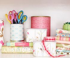 Turn coffee tins, soup cans, and powdered drink tubs into pretty storage containers by covering them with decorative papers. Cut the paper to size, then attach with spray adhesive or double-stick tape.