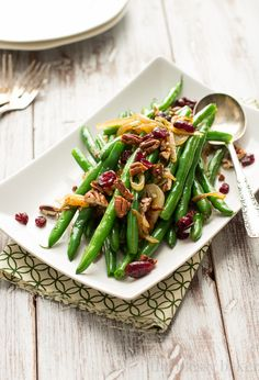 Green Beans with Caramelized Onions and Pecans: Crisp green beans tossed with caramelized onions, toasted pecans, and dried cranberries.
