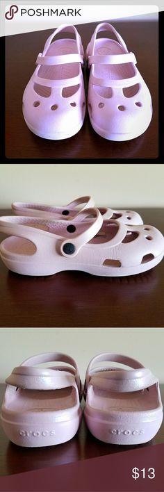 CROCS girls sandals CROCS summer sandals pink size 12. Some wear on the shoes, logo on side is rubbed off. But solid shape. CROCS Shoes Sandals & Flip Flops