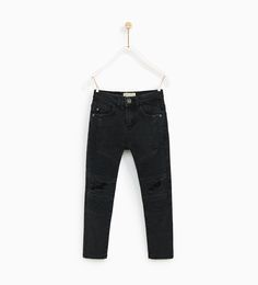 Image 1 of RIPPED BIKER TROUSERS from Zara