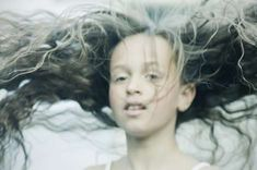 'I Am the Storm' by Lill-Veronica Skoglund Features Wild Windswept Hair #hairstyles trendhunter.com