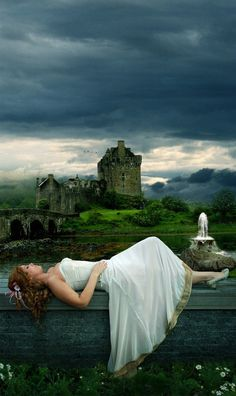 Beautiful lady dreaming in a white dress