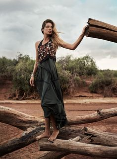 """When I woke up at the Elephant Watch Camp, where you sleep in a tent and 'shower' outside with a jerrican of water, I felt so close to nature,"" says Kroes. ""I love that in Africa, nature rules."" Bottega Veneta dress. Scotch & Soda bracelet. 1-100 thick cuff. Melissa Joy Manning thin cuff. On hair: L'Oréal Paris Advanced Hairstyle Boost It Air-Spun Texture Mist ($5, at drugstores)."