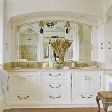 Vintage Bathroom. I like the idea of putting a drawer under the sinks instead of having to look at the ugly plumbing.