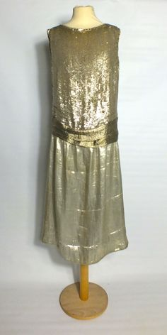 Lamé flapper dress with silver sequins.