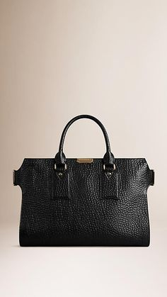 Burberry Black The Large Clifton in Signature Grain Leather - The Large Clifton in signature grain leather. Inspired by the Heritage trench coat, the design features adjustable side buckles. Discover the women's bags collection at Burberry.com