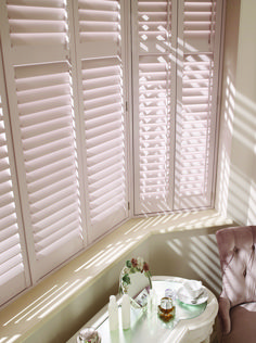 Wooden shutters are the perfect option for a bay window, as they protect your privacy but offer great light control! Shutters With Curtains, Bedroom Shutters, Indoor Shutters, White Shutters, Blinds For Windows, Diy Shutters, Burlap Curtains, Bay Window Bedroom, Bay Window Living Room