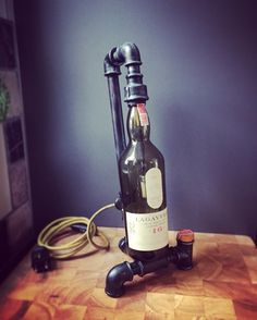 Industrial light whisky bottle. Lagavulin 16y lamp. Gas pipe lamp