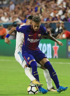 Casemiro #14 of Real Madrid and Neymar #11 of Barcelona vie for the ball during their International Champions Cup 2017 match at Hard Rock Stadium on July 29, 2017 in Miami Gardens, Florida.