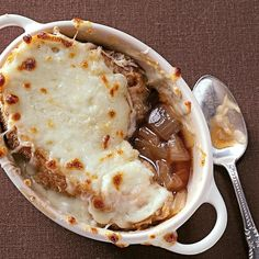 Rich French Onion Soup Recipe -When entertaining guests, I bring out this savory soup while we're waiting for the main course. It's simple to make—just saute the onions early in the day and let the soup simmer until dinner-time. In winter, big bowls of it make a warming supper with a salad and biscuits. —Linda Adolph, Edmonton, Alberta
