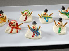 Melting Snowman Bark: Puddles of creamy white chocolate harden into delightful holiday treats without turning on the oven. Decorate them with different candies.