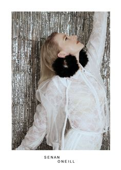 Senan oneill S/S campaign shoot imaginary Organza bomber - Lace sports stripe blouse with trans plastic detail - Metal and marabou earrings