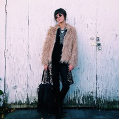 Adore the vintage feeling statement necklace, and as always, the faux fur coat, skinny pants, and ankle boots