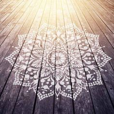 Passion Mandala Stencil from Cutting Edge Stencils painted on a wooden deck adds beauty and character to an outdoor space. http://www.cuttingedgestencils.com/passion-mandala-stencil-yoga-decal-wall-stencils-mandalas.html