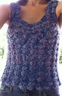 I finished the crocheted shell tank top. Made with Araucania Mataquito Yarn. It is a bit thicker than called for, but the pattern is pretty easy to resize.  https://www.pinterest.com/pin/428967933233884257/
