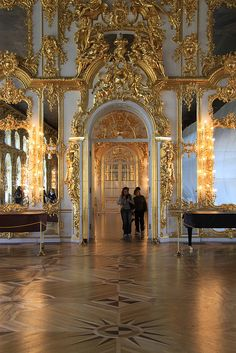 The Great Hall, Catherine Palace, near Saint Petersburg, Russia. Note the magnificent floors inlaid with precious woods. When you enter, you are given paper slippers at the door, so the floors will not be damaged.