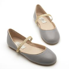 The prettiest low-cut ballerina with a soft-gold elastic over the foot for support. Beautiful under a dress but works well with jeans too. The light grey is very versatile.