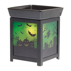 #PUMPKIN #GRAVEYARD #SCENTSY WARMER Ghoulish and glowing with green moonlight, Pumpkin Graveyard casts haunting shadows for chilling ambiance.  The same lightbulb inside that creates the eery glow also melts the Scentsy wax in the dish on top, filling your home with amazing scent!  Buy online at https://sattler.scentsy.us